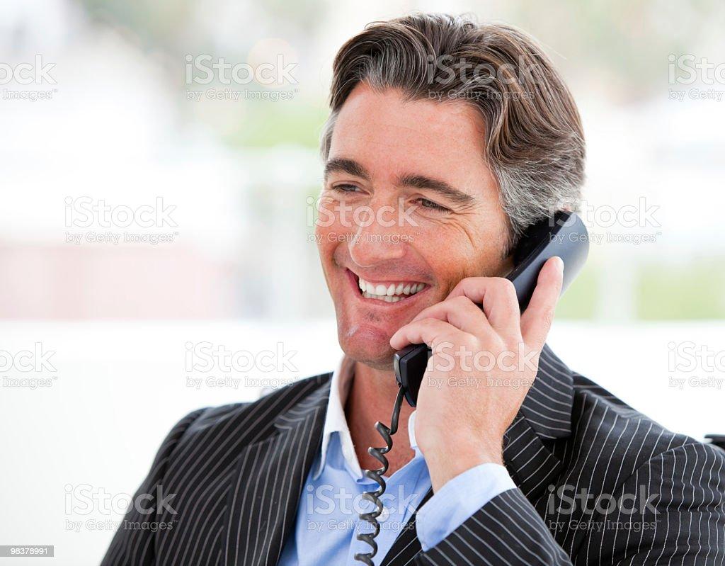 Smiling businessman on phone royalty-free stock photo