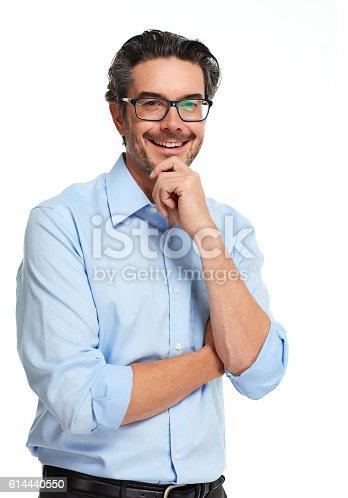istock Smiling businessman. 614440550