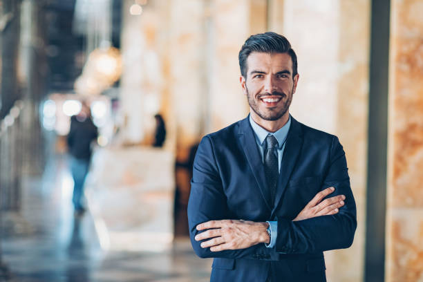 Smiling businessman Businessman with arms crossed looking at camera salesman stock pictures, royalty-free photos & images