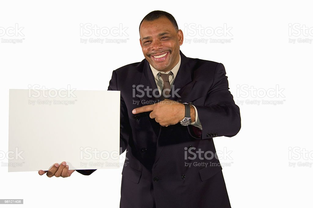 smiling businessman pointing at a white board royalty-free stock photo