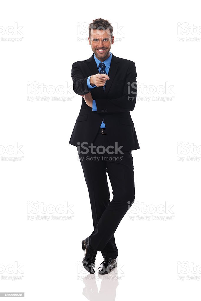 Smiling businessman pointing at camera side royalty-free stock photo