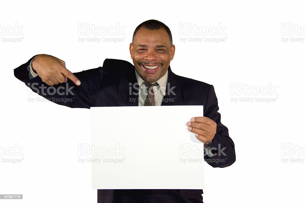 smiling businessman pointing at picture board royalty-free stock photo