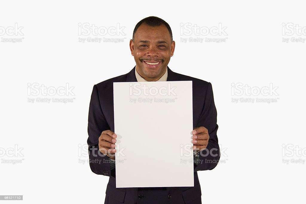 Immagine di Uomo d'affari sorridente che presenta scheda foto stock royalty-free