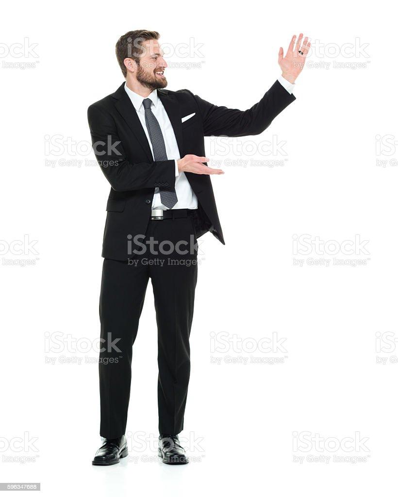 Lächelnd Geschäftsmann präsentiert  Lizenzfreies stock-foto