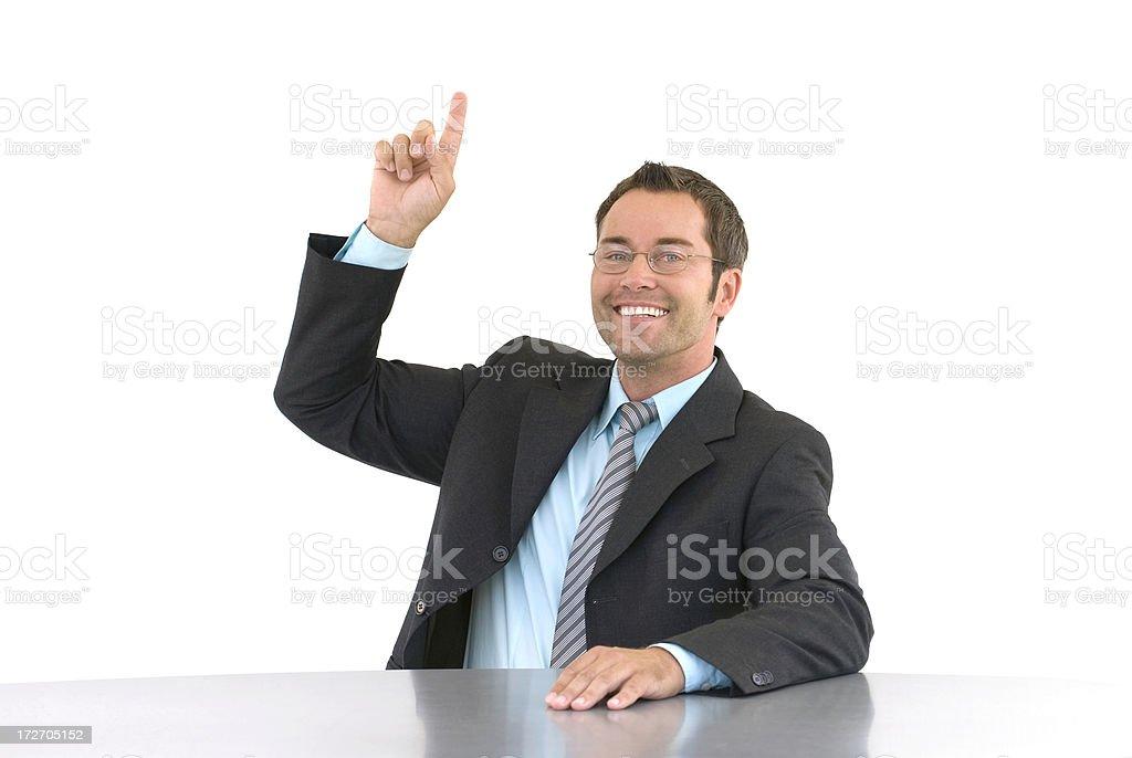 smiling businessman raising his arm royalty-free stock photo