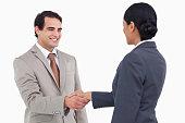 istock Smiling businessman shaking hand of businesspartner 824924684