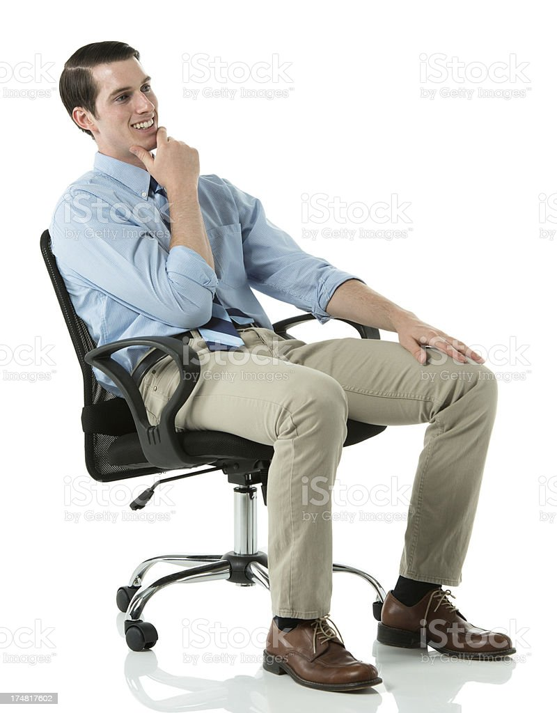 Smiling businessman sitting in a chair royalty-free stock photo