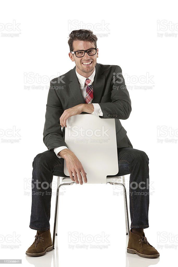 Smiling businessman sitting on a chair royalty-free stock photo
