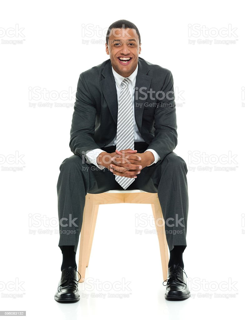 Smiling businessman sitting on chair royalty-free stock photo