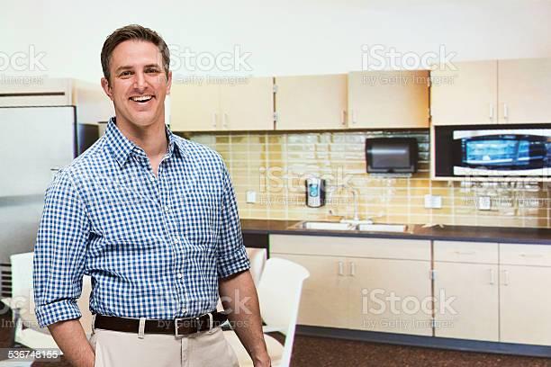 Smiling businessman standing in kitchen picture id536748155?b=1&k=6&m=536748155&s=612x612&h=wmqazsjc3xfqi9fth0ajah742mqd6avcpbxnui85ud4=