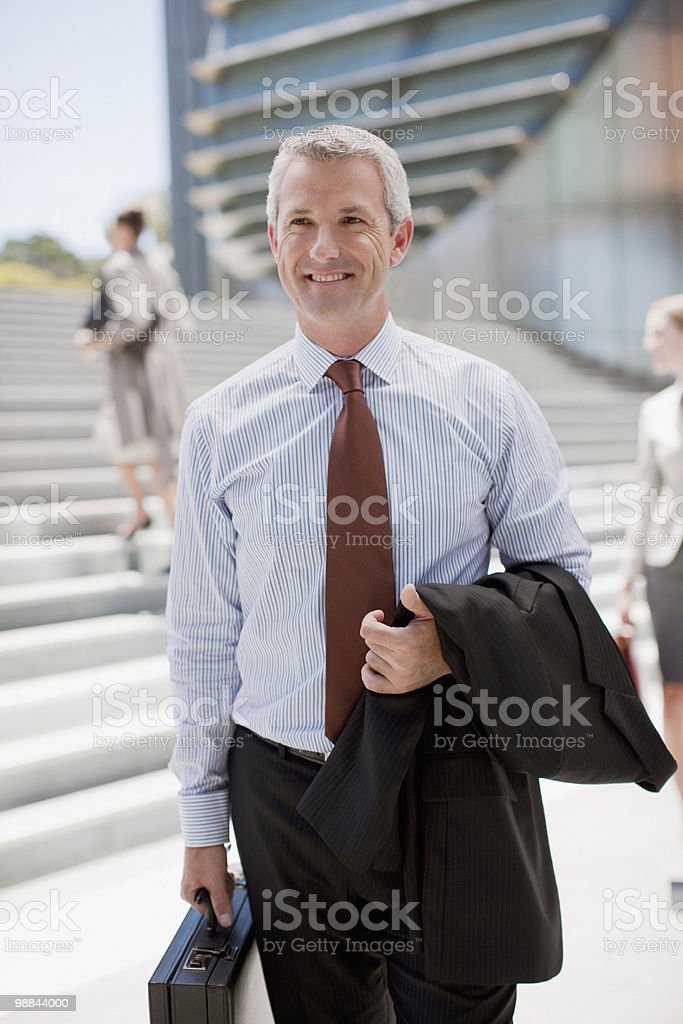 Smiling businessman standing outdoors 免版稅 stock photo