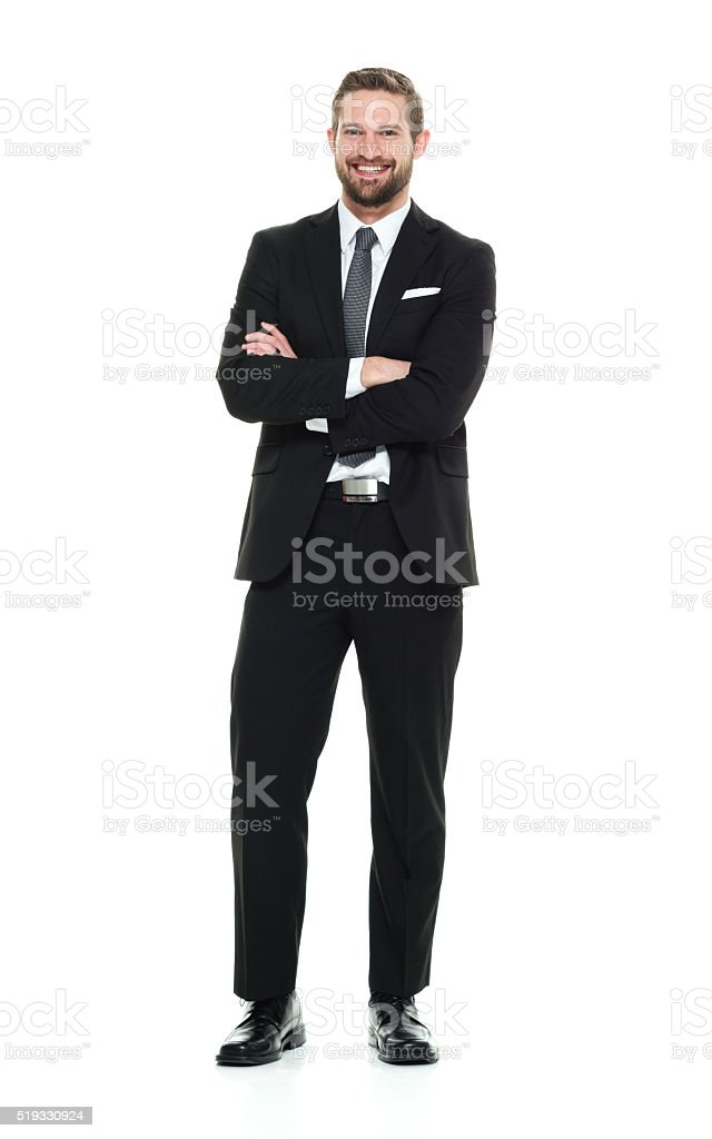 Smiling businessman standing stock photo