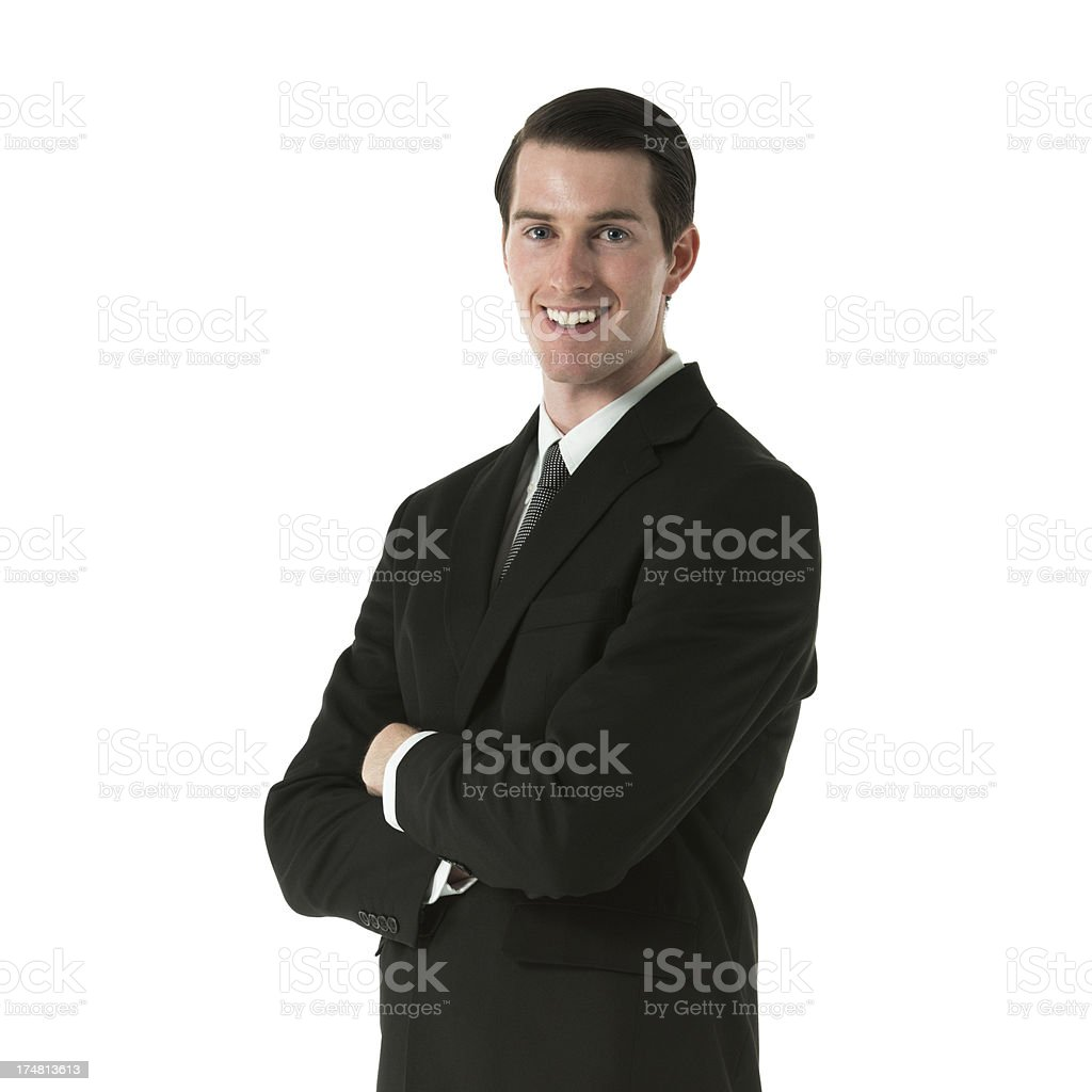 Smiling businessman standing with his arms crossed royalty-free stock photo