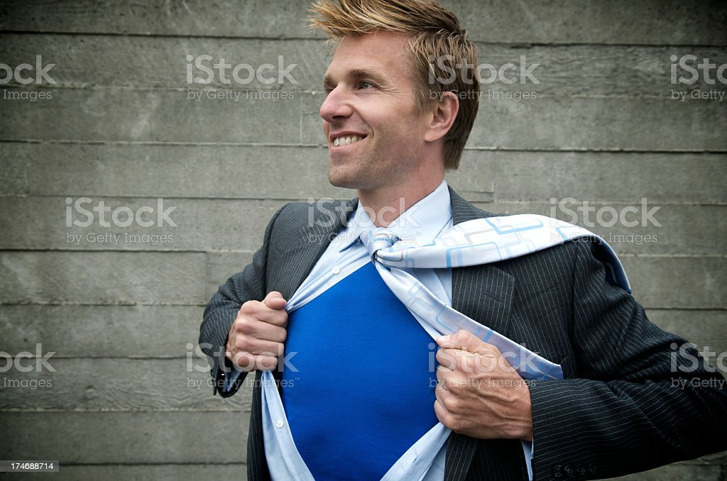 Smiling Businessman Superhero Outdoors Gritty Concrete Wall royalty-free stock photo