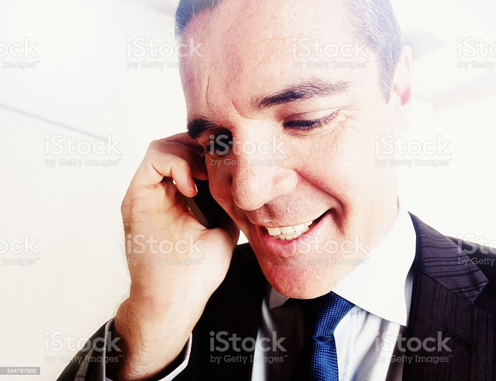 Smiling Businessman Talking On Cellphone Fisheye Lens Distortion Stock  Photo - Download Image Now
