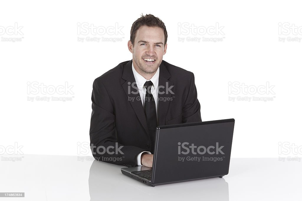 Smiling businessman using a laptop royalty-free stock photo