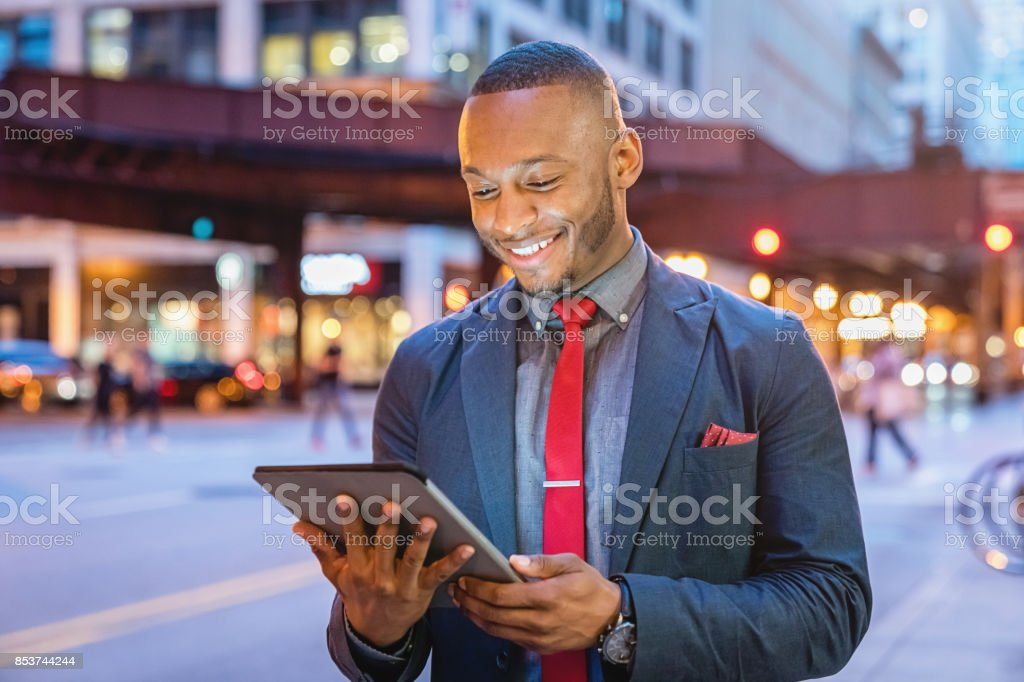 Smiling Businessman using Tablet Computer Chicago Streets stock photo