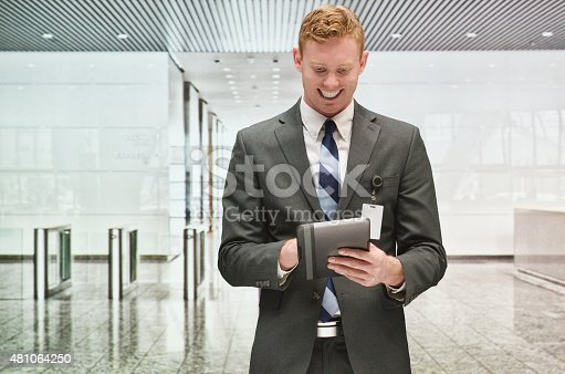 Smiling businessman using tablet in officehttp://www.twodozendesign.info/i/1.png