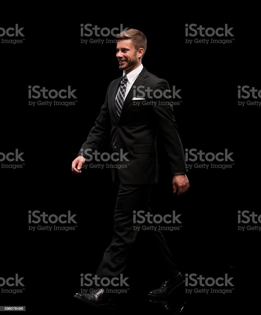 Smiling businessman walking royalty-free stock photo