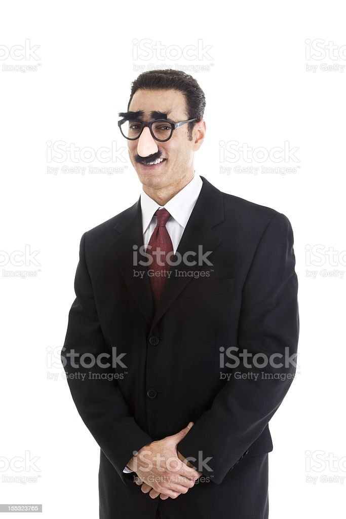 Smiling Businessman Wearing Grouch Marx Glasses Looking At Camera Isolated stock photo