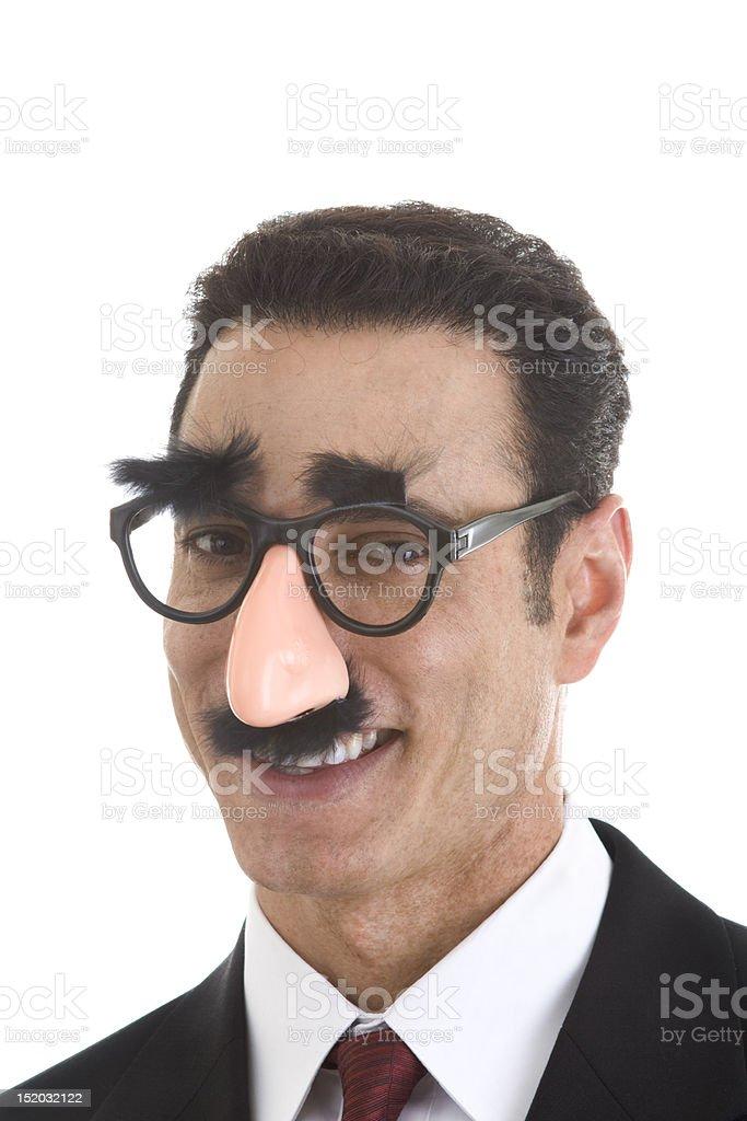 Smiling Businessman Wearing Groucho Marx Glasses Isolated on White Background stock photo