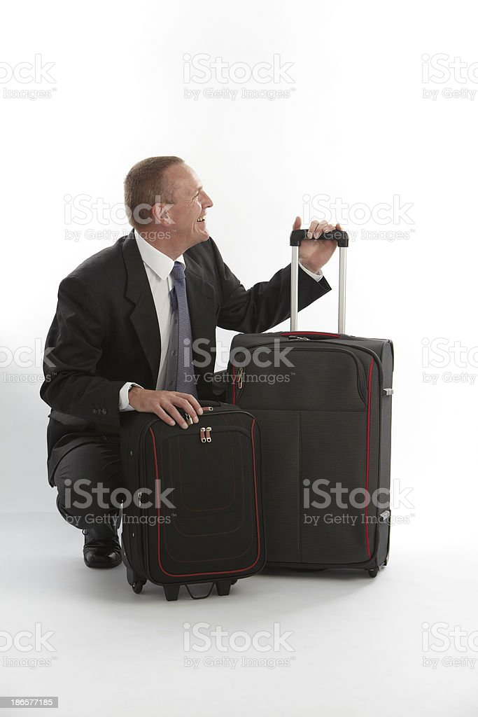 Smiling businessman with cases royalty-free stock photo
