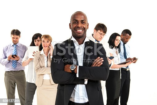 istock Smiling businessman with crossed arms in the office 639137344