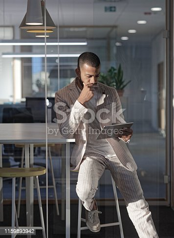 istock Smiling businessman  with digital tablet 1159893942