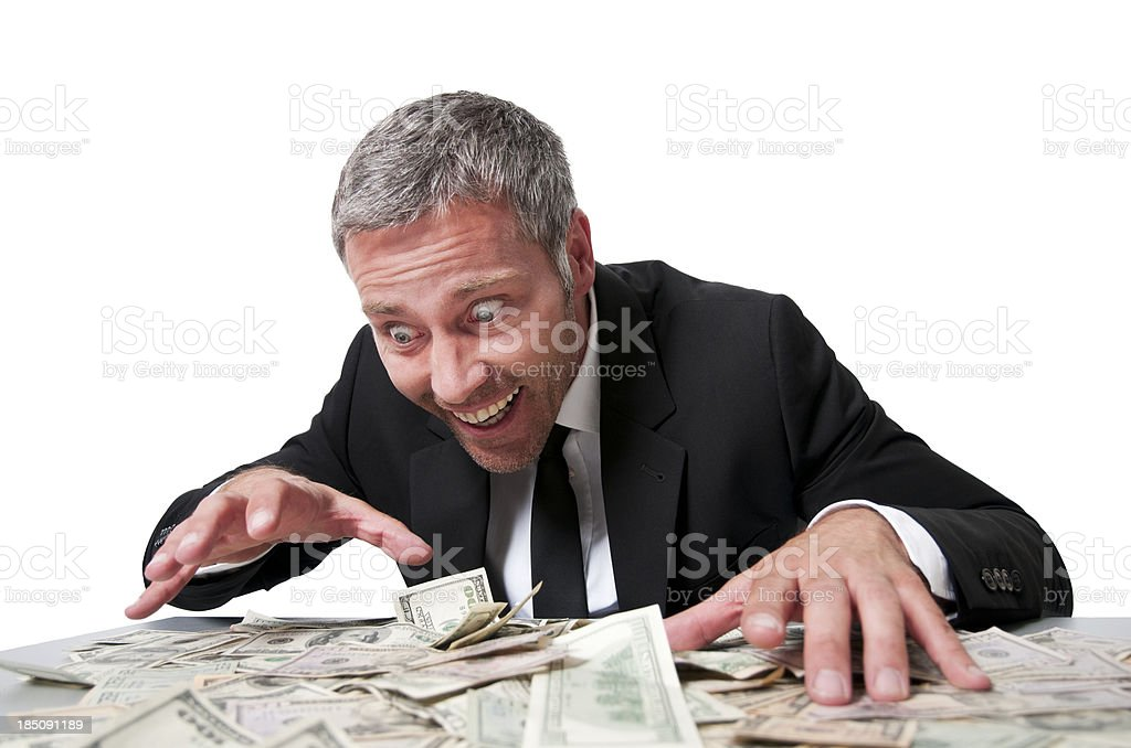 Smiling businessman with dollar bills stock photo