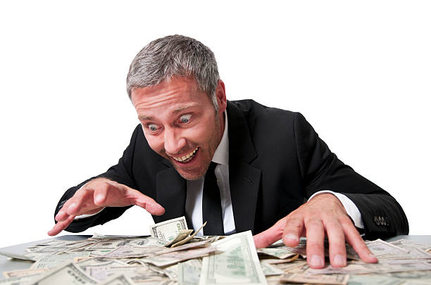 Smiling businessman with dollar bills happy businessman grabbing for lots of dollar bills greed stock pictures, royalty-free photos & images