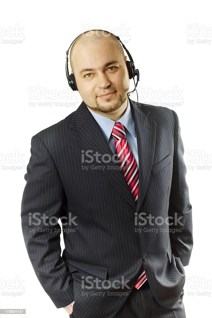 Smiling businessman with headphones royalty-free stock photo