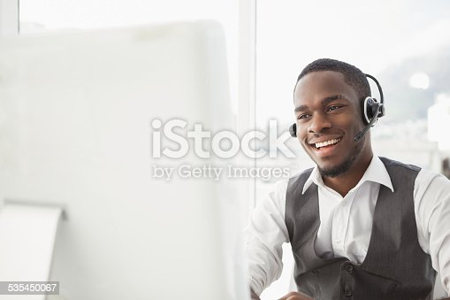 istock Smiling businessman with headset interacting 535450067