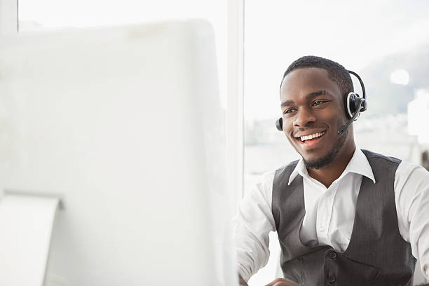 smiling businessman with headset interacting - call center 個照片及圖片檔