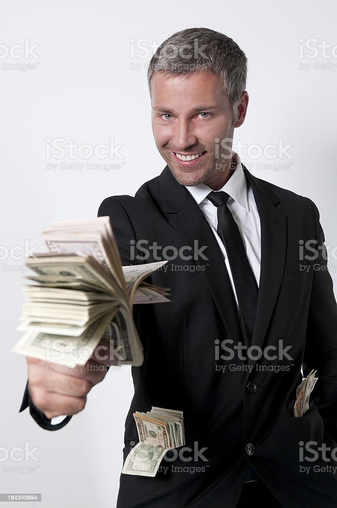smiling businessman with lots of dollars stock photo