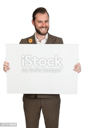 istock Smiling businessman with paper for copy space 917478808