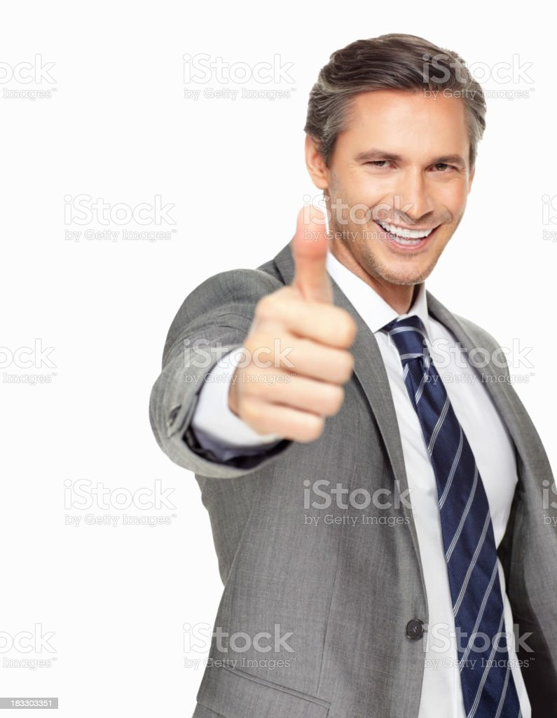 Smiling businessman with the thumbs up gesture royalty-free stock photo