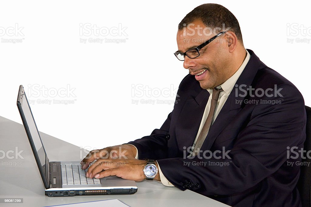 smiling businessman working at laptop royalty-free stock photo