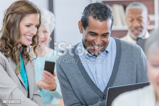 640177838 istock photo Smiling businesspeople attend conference 667548220
