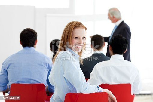 640177838 istock photo Smiling businesswoman at a conference 856130526