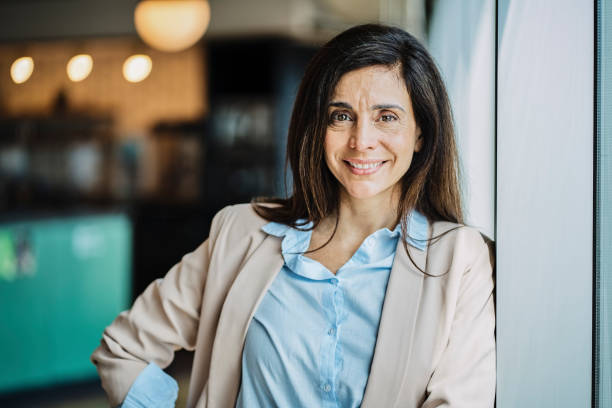 Smiling businesswoman at coworking office stock photo