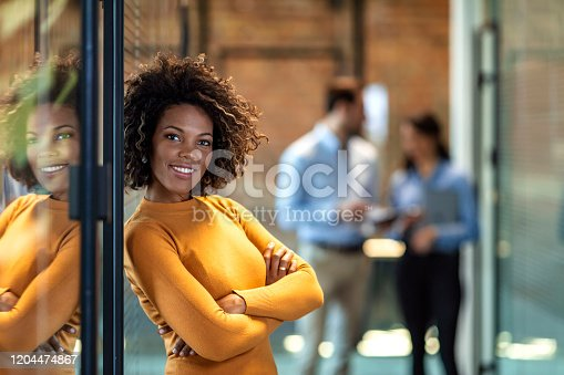 One Confident successful smiling business woman executive with folded arms