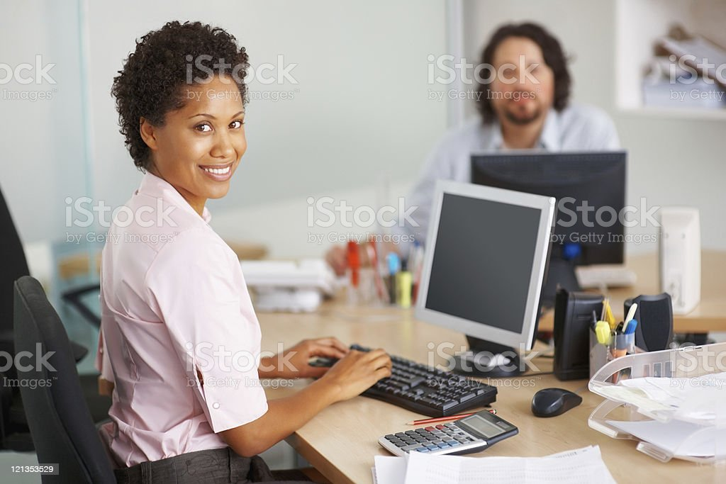 Smiling businesswoman busy working royalty-free stock photo