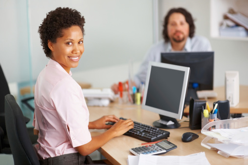 Smiling Businesswoman Busy Working Stock Photo - Download Image Now