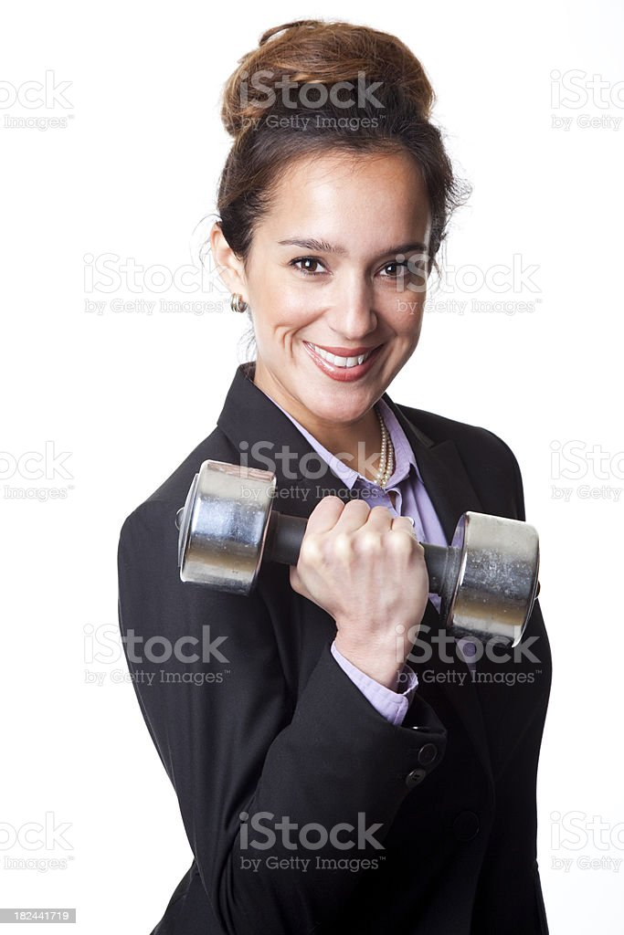 smiling businesswoman carrying heavy dumbbell royalty-free stock photo