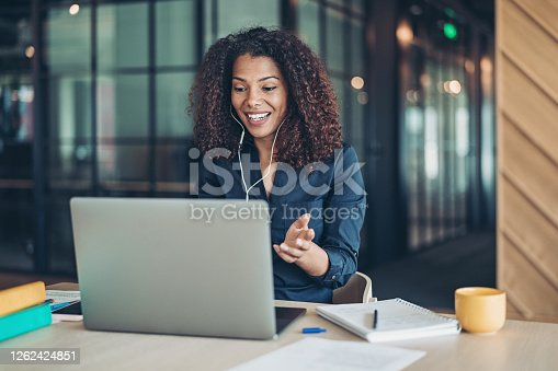 Businesswoman with a laptop having a video call