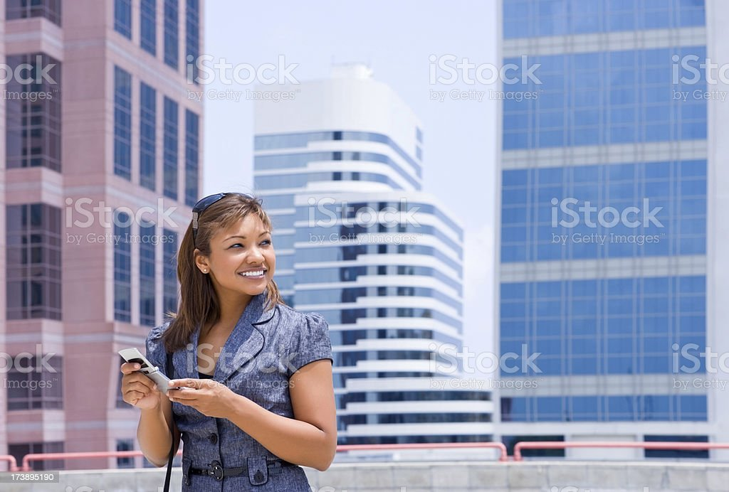 Smiling businesswoman holding cellphone royalty-free stock photo