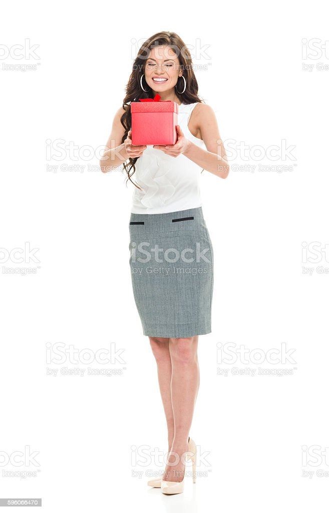 Smiling businesswoman holding gift box royalty-free stock photo