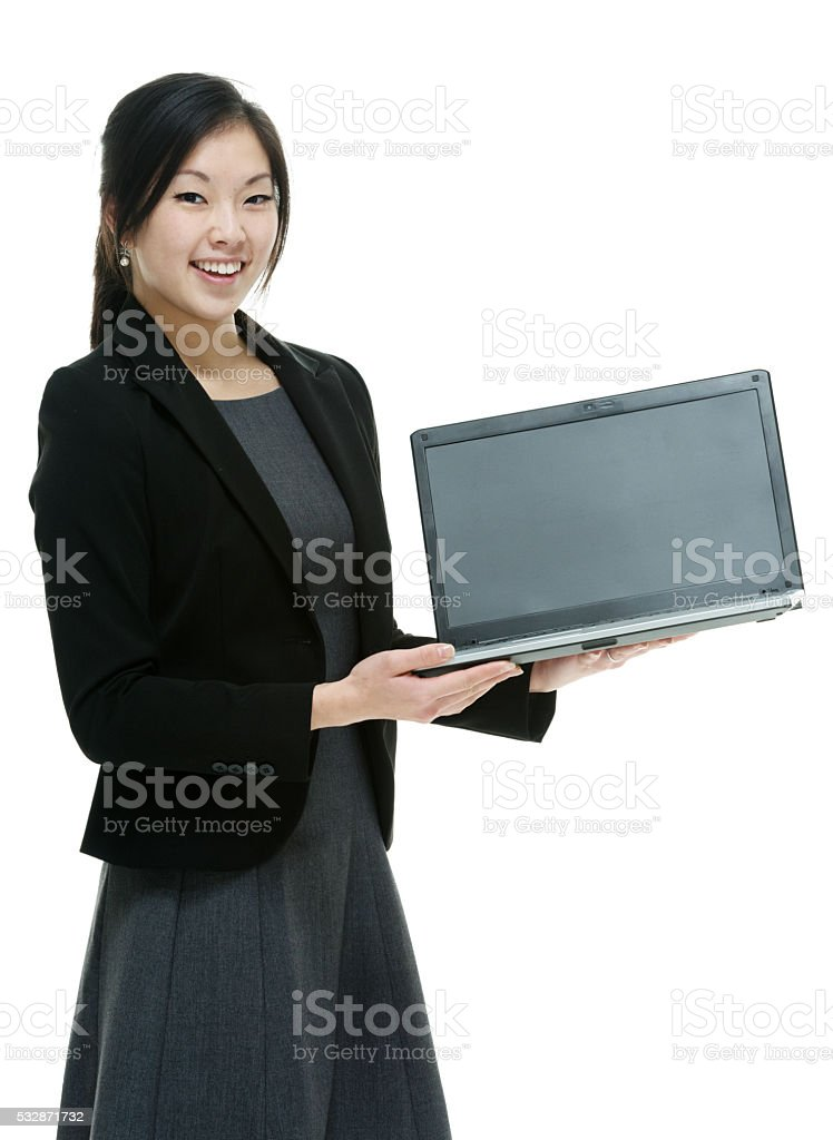Smiling businesswoman holding laptop stock photo
