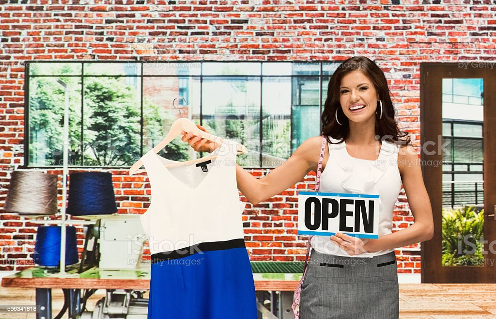Smiling businesswoman holding open sign royalty-free stock photo