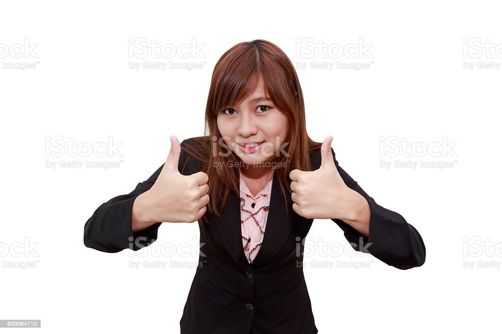 Smiling businesswoman holding thumps up stock photo